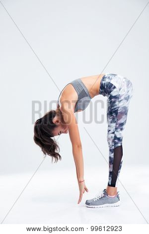 Full length portrait of a fitness woman workout isolated on a white background