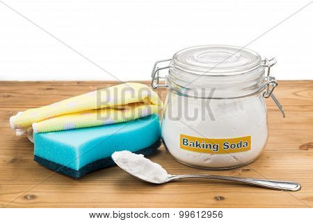 Baking Soda With Sponge And Towel For Effective House Cleaning.