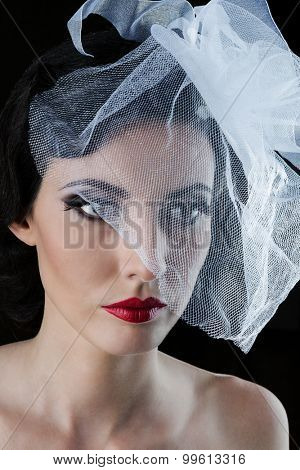 beautiful woman with a veil on a black background