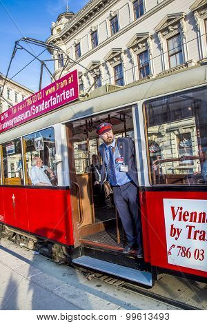 Conductor At Old Red Vintage Tram Operating In Vienna.