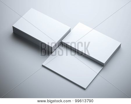 Three stacks of blank business cards