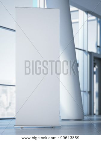 Blank roll up banner at the modern office. 3d rendering