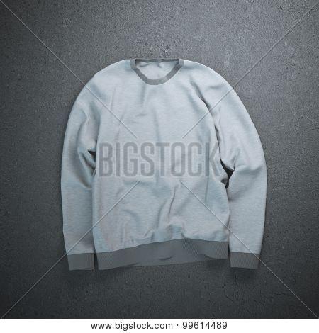 Gray sweatshirt on the concrete floor