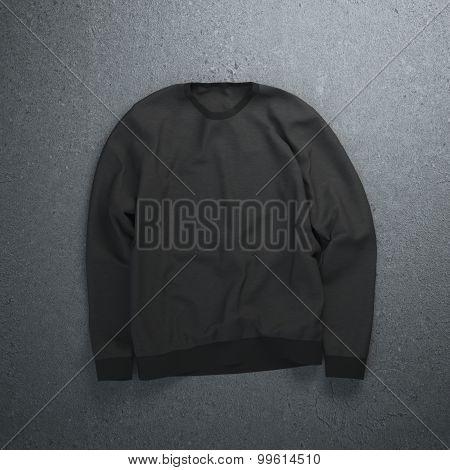 Black sweatshirt on the concrete floor