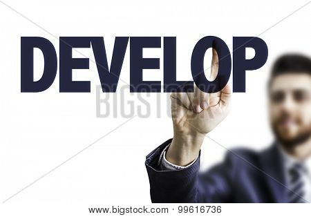 Business man pointing the text: Develop