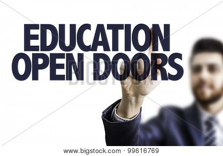 Business man pointing the text: Education Open Doors