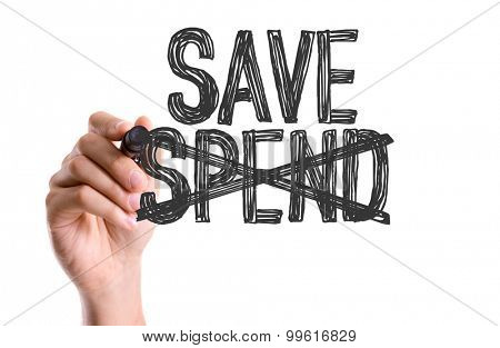 Hand with marker writing the word Save Spend