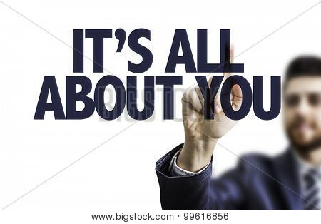 Business man pointing the text: It's All About You