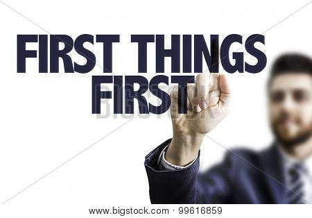 Business man pointing the text: First Things First