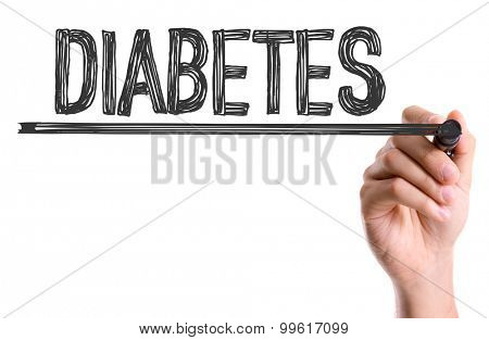 Hand with marker writing the word Diabetes