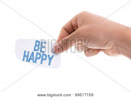 Piece of paper with the word Be Happy isolated on white background