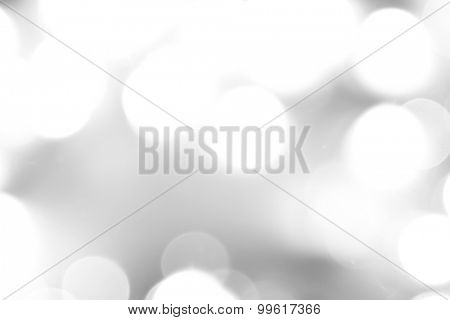 Abstract grey and white defocused bokeh circles background