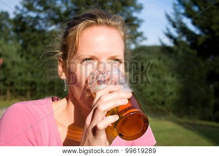 Portrait Of Young Pretty Woman With Beer