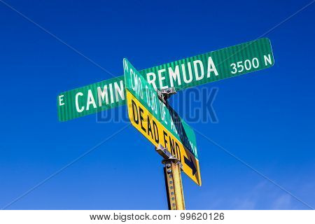 Street Names On Green Signs Under Blue Sky In Tuscon