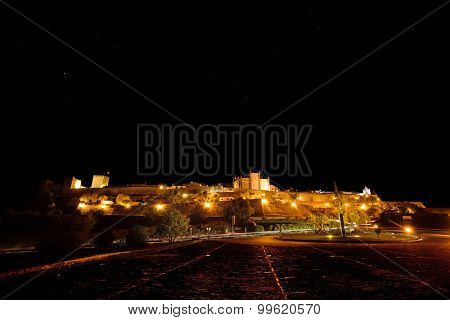 Europe, Portugal, Alentejo-View of the medieval village of Monsaraz at night with visible natural stars and constellations.