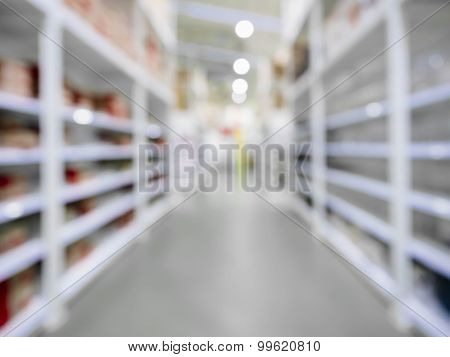 Blurred Shelf Storage In Retail Shop Warehouse Perspective