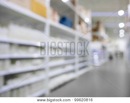 Blurred Shelf Display Storage In Retail Shop Warehouse Perspective