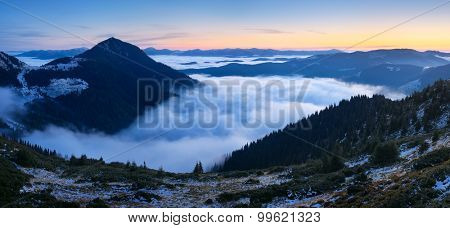 Mountain landscape at dawn. Panorama with beautiful clouds and fog. Carpathians, Ukraine, Europe