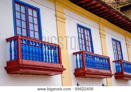 Beautiful historic red and blue balconies from the main square at city Zipaquira.