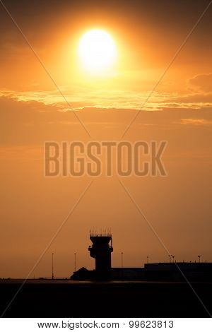 Sunset Orange Sillouette and Flight Tower Canada