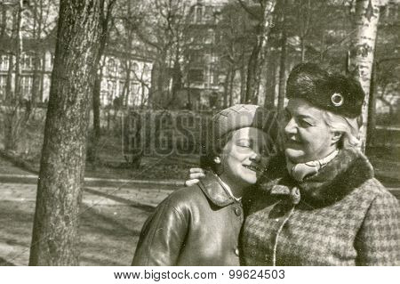 Vintage photo of mother and daughter in park, 1950's