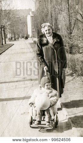 Vintage photo of mother and daughter, 1950's