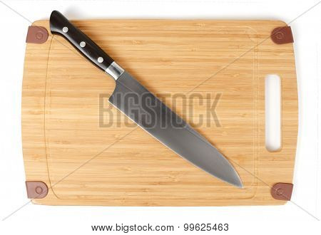 Chef's knife on a cutting board isolated over white