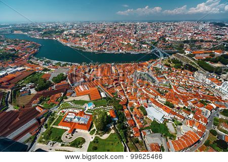 Aerial shot of the city of Porto and the city of Vila Nova de Gaia at sunny day