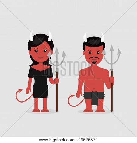 Male and a female in a devil costume with a trident
