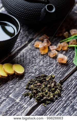 Green tea composition on wooden background, closeup view