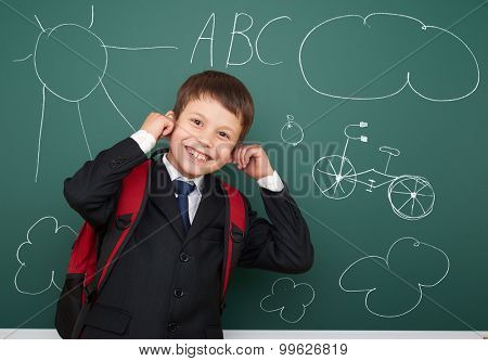 school boy drawing fun object on board