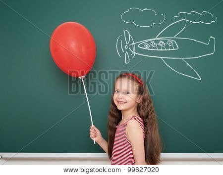 girl with balloon draw plane on school board
