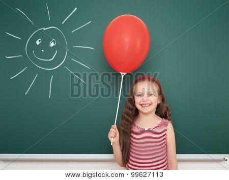 girl with balloon draw sun on school board