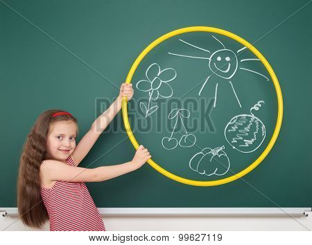 girl with hoop draw sun and flowers on board