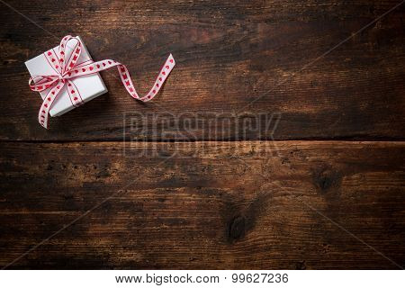 Gift boxes over dark wooden background