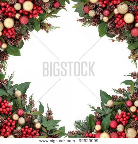 Christmas red and gold bauble decorations, holly, mistletoe, ivy, pine cones and traditional greenery over white background.