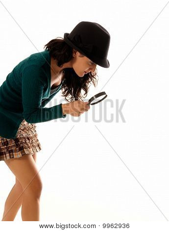 Young Woman With Magnifier Glass And Hat Looking For Something Isolated On White Background