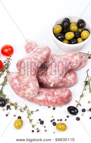 Uncooked Raw Sausages With Serving Spices