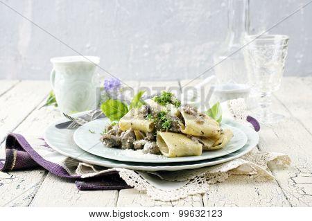 italian pasta with minced meat Mezzi Occhi di Lupo