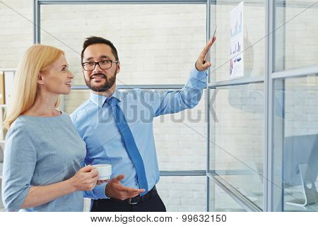Manager talking to his chief about new strategy