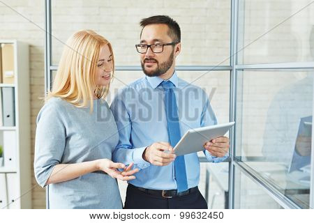 Young manager talking to female chief