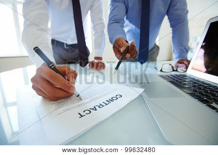 Two partners revising terms and conditions of contract