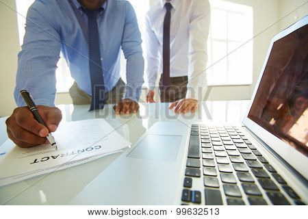 Businessman consulting with lawyer on contract