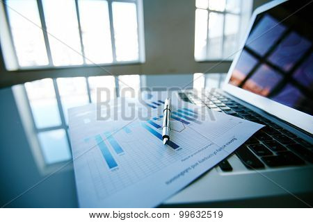 Close-up of financial report left on keyboard
