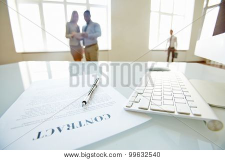 Businesspeople going to sign a contract