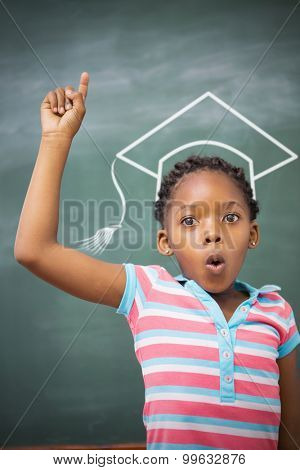 Graduation hat vector against pupils raising hand in classroom