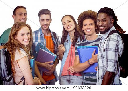 Smiling group of students holding folders against white background with vignette