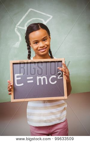 Theory of relativity against portrait of cute little girl holding school slate