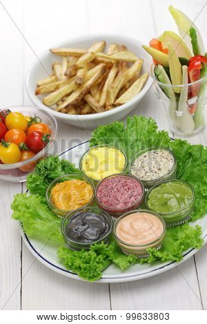assorted mayonnaise sauce with french fries and raw vegetables