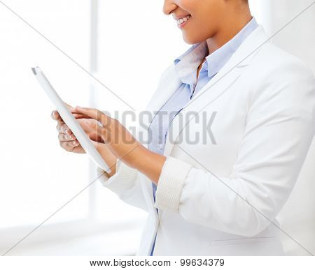 office, business, technology and internet concept - businesswoman with tablet pc in office